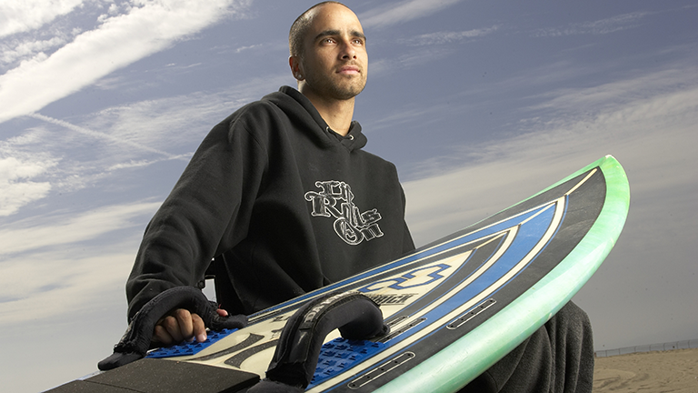 Wellspect J Billauer Lofric Ambassador with surf board